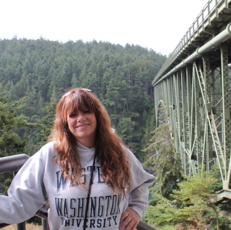 Lori Torres standing next to a bridge