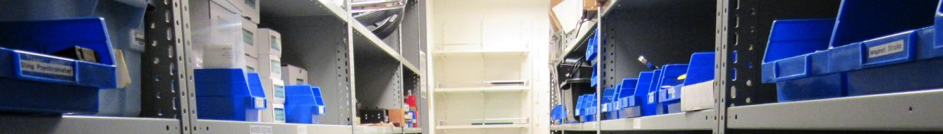 Stockroom shelves, filled with blue plastic containers